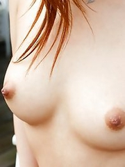 Redhead japanese model Ren Azumi shows her nice body and strips
