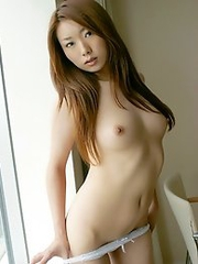 Naked and horny Japanese av idol Yu Minami shows her nude body to viewers